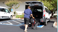 wheelchair using ramp in the Ford Transit van