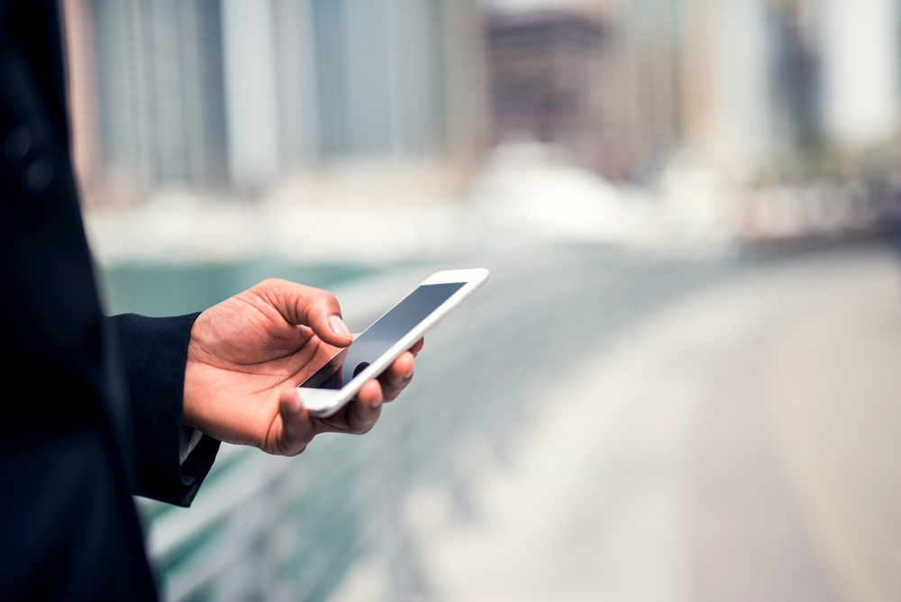 person using mobile phone - shutterstock_488393074