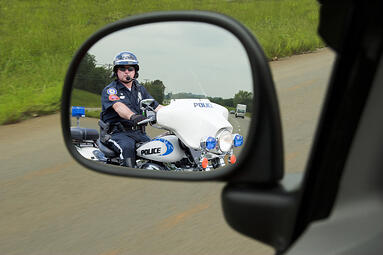police officer in rearview mirror